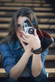 Young girl with old camera Royalty Free Stock Photo