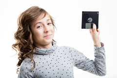 Young girl with old disk Stock Images