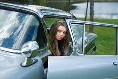 Young girl in old-fashioned car Royalty Free Stock Photo