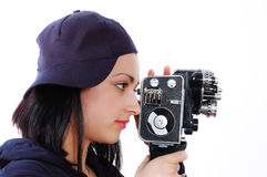 Young girl with old film (movie) camera Royalty Free Stock Photo