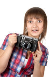 Young girl with old photo by camera Stock Photo