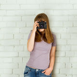 Young girl with an old vintage camera Stock Photography