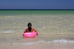 Young Girl On Pink Air-bed In Stock Photography