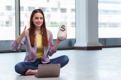The young girl in online business concept Stock Photography