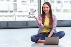 The young girl in online shopping concept Stock Images