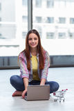 The young girl in online shopping concept Stock Image