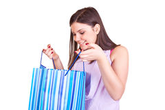 Young girl opening the gift Stock Photos