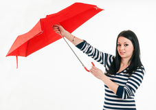 Young girl opening her red umbrella Royalty Free Stock Images