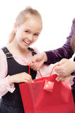 Young girl opens bag Stock Image