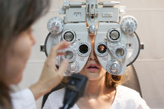 Young girl at optometry revision Royalty Free Stock Image