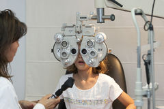 Young girl at optometry revision wide view Royalty Free Stock Photo