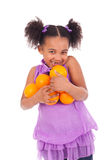Young girl with orange Stock Photos