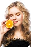 Young girl with orange Royalty Free Stock Images