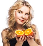 Young girl with orange Stock Images