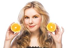 Young girl with orange Stock Photography