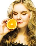 Young girl with orange Royalty Free Stock Photos