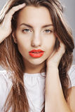 Young girl with orange lips Royalty Free Stock Photos