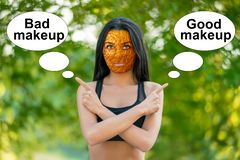 Young girl with orange peel skin, bad skin sign, shows the words royalty free stock photo