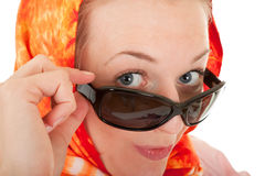 Young girl with orange shawl. Young girl with a  orange shawl and sunglasses Royalty Free Stock Photography