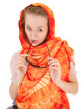 Young girl with orange shawl. Young girl with a  orange shawl and sunglasses Stock Photo