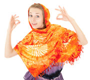 Young girl with orange shawl Stock Image