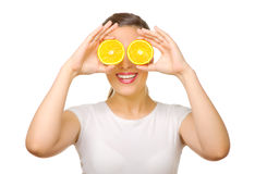 Young girl with orange slices Royalty Free Stock Photo