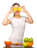 Young girl with orange slices Royalty Free Stock Photography