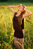 Young girl outdoor on the field Royalty Free Stock Photos