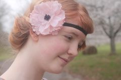 Red Haired Girl With a Flowered Headband Royalty Free Stock Images