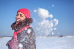Young girl outdoor in winter throws snow Royalty Free Stock Photos