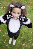 Young girl outdoors in cat costume on Halloween Stock Photos