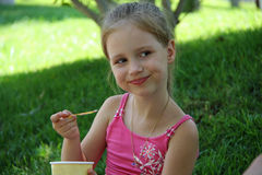 Young girl outdoors eating ice cream Royalty Free Stock Photo