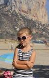 Young girl outdoors eating lollipop Stock Photos