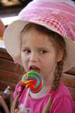 Young girl outdoors eating lollipop Stock Photo