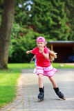 Young girl outdoors inline skating fun Stock Photo