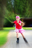 Young girl outdoors inline skating fun radial blur Royalty Free Stock Photos