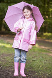 Young girl outdoors with umbrella smiling Royalty Free Stock Photography
