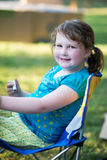 Young girl outside coloring with markers Royalty Free Stock Photography