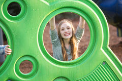 Young girl outside at school playground Royalty Free Stock Images