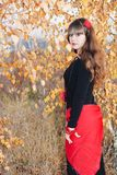 Young girl over autumnal background Royalty Free Stock Image