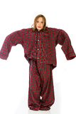 Young girl in over sized pajamas. A cute young girl wearing huge pajamas that are over sized for her Stock Photography