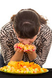 Young girl overeating junk food Royalty Free Stock Photography