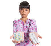 Young Girl And Pack Of Medicine Pills II Royalty Free Stock Photos