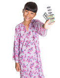 Young Girl And Pack Of Medicine Pills IX Royalty Free Stock Photography