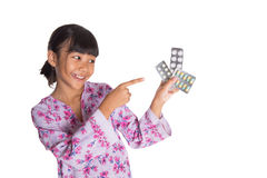 Young Girl And Pack Of Medicine Pills XII Stock Photography