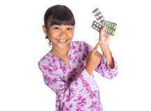 Young Girl And Pack Of Medicine Pills XIII Stock Photos