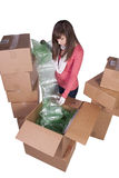 Young girl packing up and moving - isolated Royalty Free Stock Image
