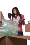 Young girl packing up and moving - isolated Stock Photos
