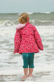 Young girl paddling in the cold sea Royalty Free Stock Image