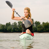 Young girl paddling in kayak Royalty Free Stock Photography